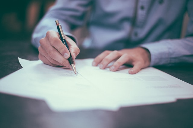 stock image signing documents